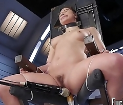 Tiedup machine babe enjoys pussy stretching