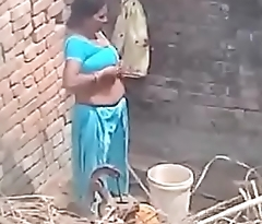 My Neighbour aunty Bathing showing her big boobs.
