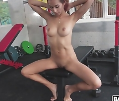Hot MILF strips all nude during workout in the gym