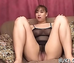 Oriental babe gives handjob and footjob in bukkake scenes
