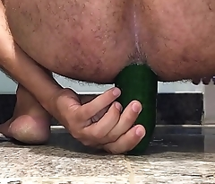 Riding a huge cucumber in my ass pussy
